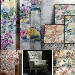a curtain in a colourful printed fabric in a watercolour paited style and picture frames containing the same fabric in other colours